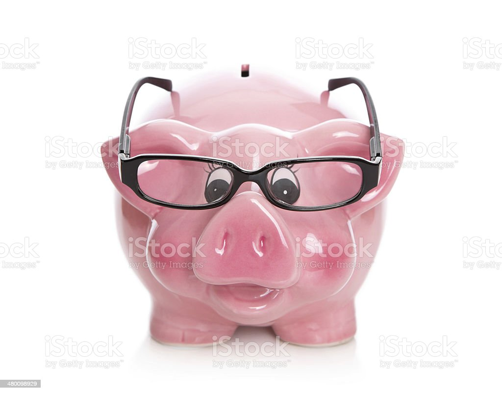Pink isolated piggy bank with glasses on white. royalty-free stock photo