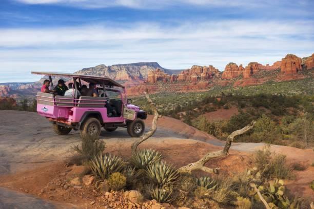 Pink Jeep Terrain Vehicle Tourists Sedona Arizona Broken Arrow Slick Rock stock photo