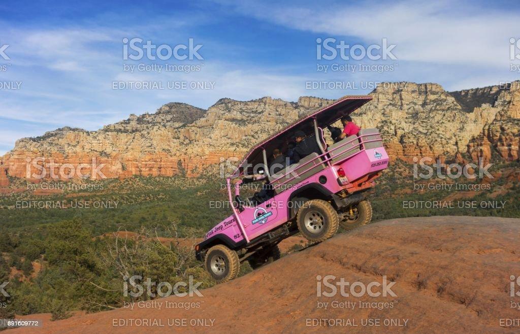 Pink Jeep Terrain Vehicle with Tourists on Sedona Slick Rock stock photo