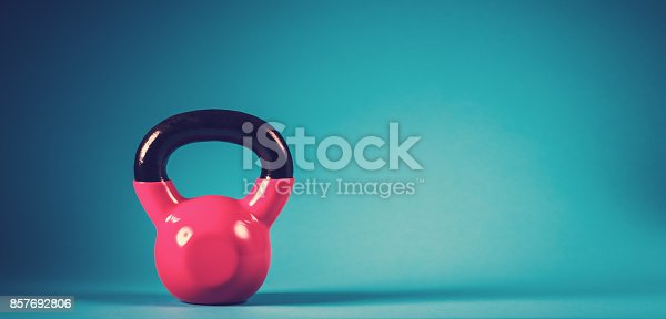 istock Pink kettlebell on a blue background 857692806