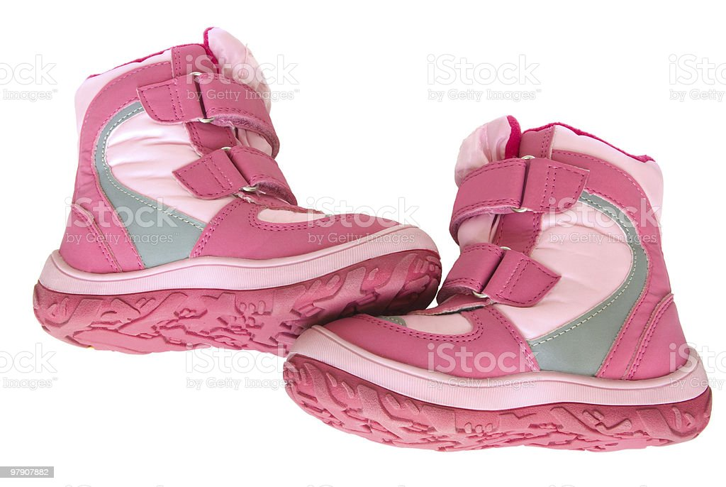 Pink kid's warm boots. royalty-free stock photo