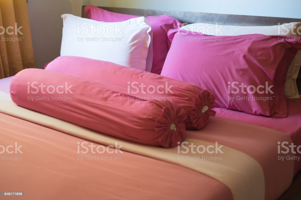 Pink king size bed in apartment stock photo