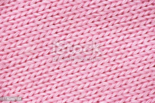 Pink knitting sweater pattern close up. Soft and sweet concept.