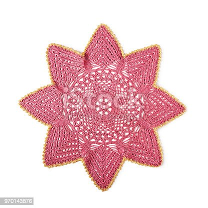 Crocheted coaster lace doily, star or snowflake shaped, christmas decoration isolated on white background clipping path included. Design element, flat lay
