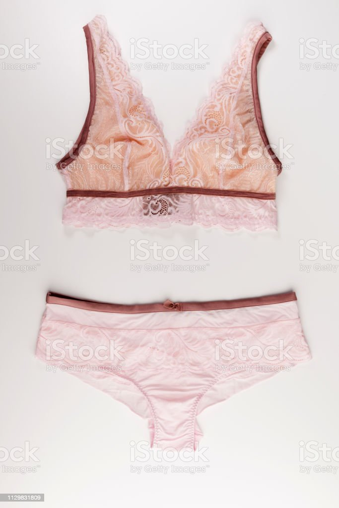 pink lace tender lingerie set isolated on a white background, top view stock photo