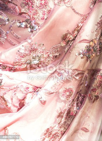 Dallas, Texas, USA, November 8, 2015- Close up of a skirt of a dress. The material is decorated with sequins, rhinestones, and glitter.