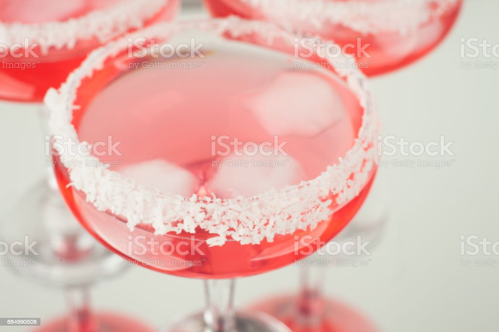 Pink lady cocktail in glass decorated with coconut and ice for Valentines day Lizenzfreies stock-foto