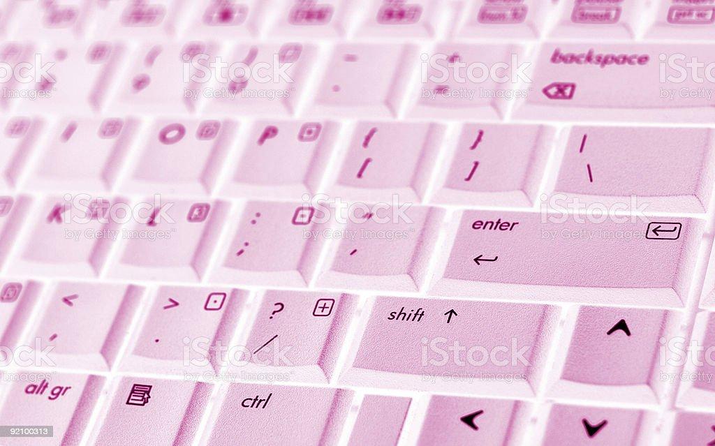 Pink laptop keyboard closeup stock photo