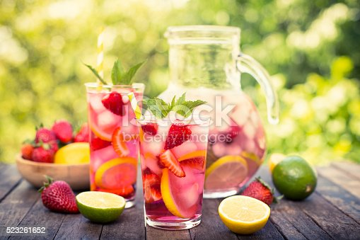 istock Pink lemonade with lemon, lime and strawberries 523261652