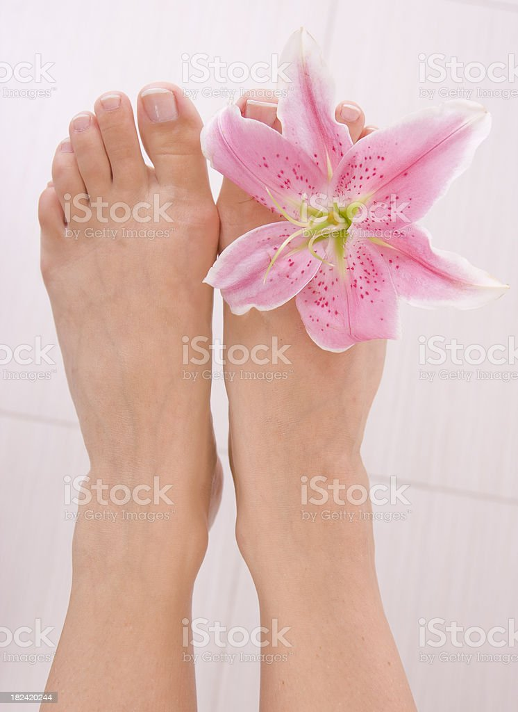 Pink lily and feet royalty-free stock photo
