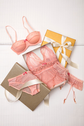Pink lingerie set with gift box isolated on white background