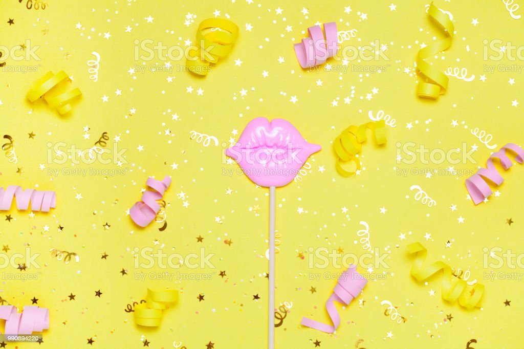 pink lips for fun on yellow festive background. stock photo