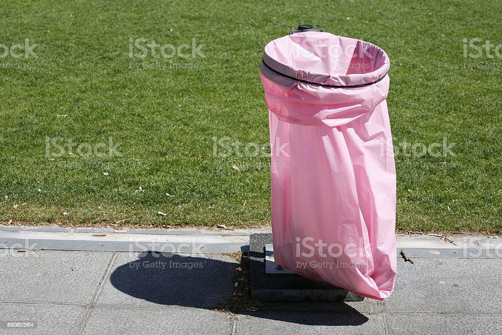 Pink litter bag royalty-free stock photo