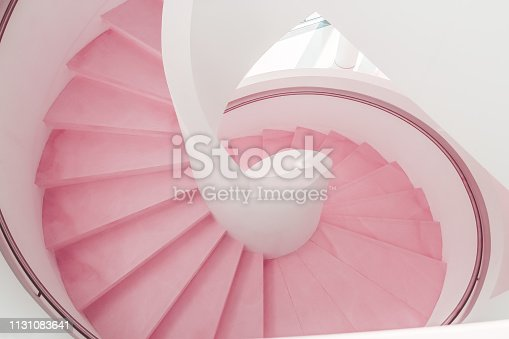 istock Pink living coral modern spiral staircase descent 1131083641