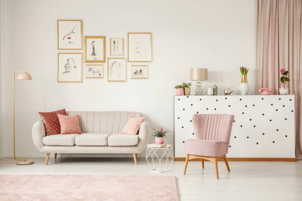 pink living room with posters - femininity stock pictures, royalty-free photos & images
