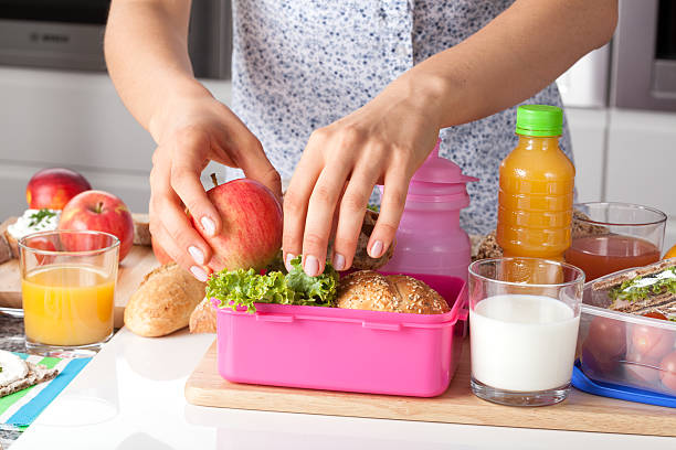 pink lunch box for little girl - lunchlåda bildbanksfoton och bilder