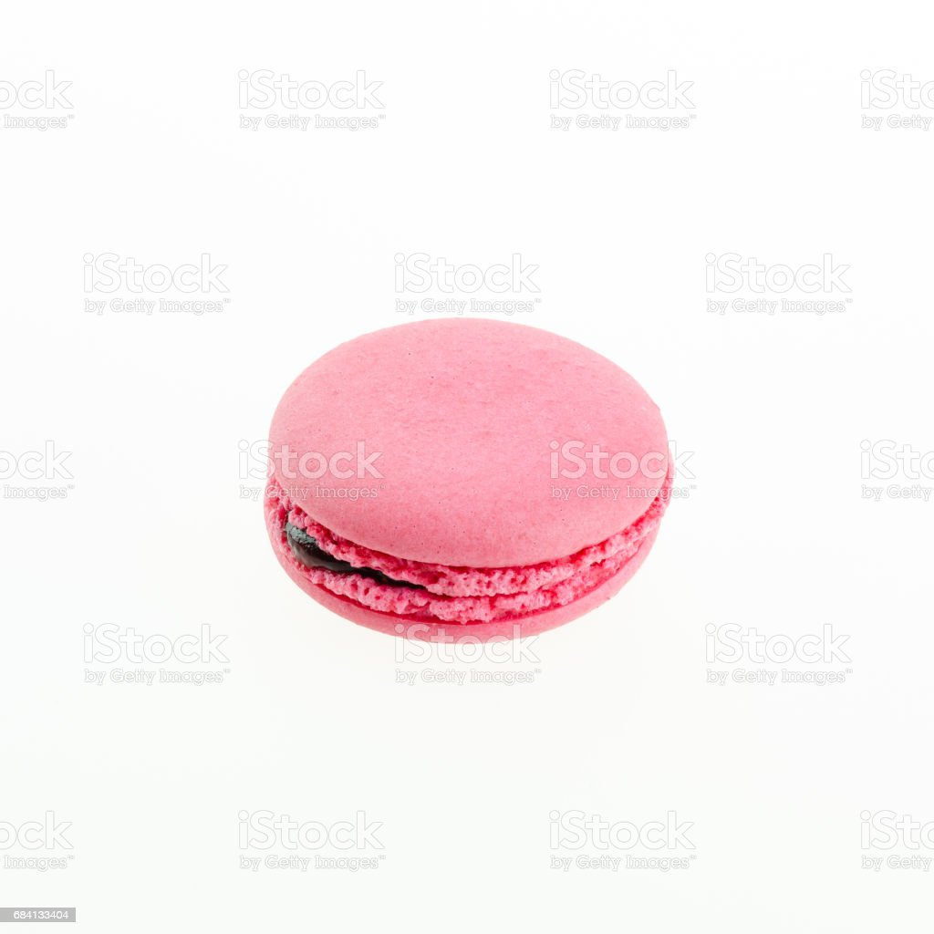 pink macaron on white background royalty free stockfoto