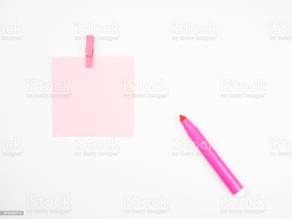 pink magic pen with paper note and paperclip on white background stock photo