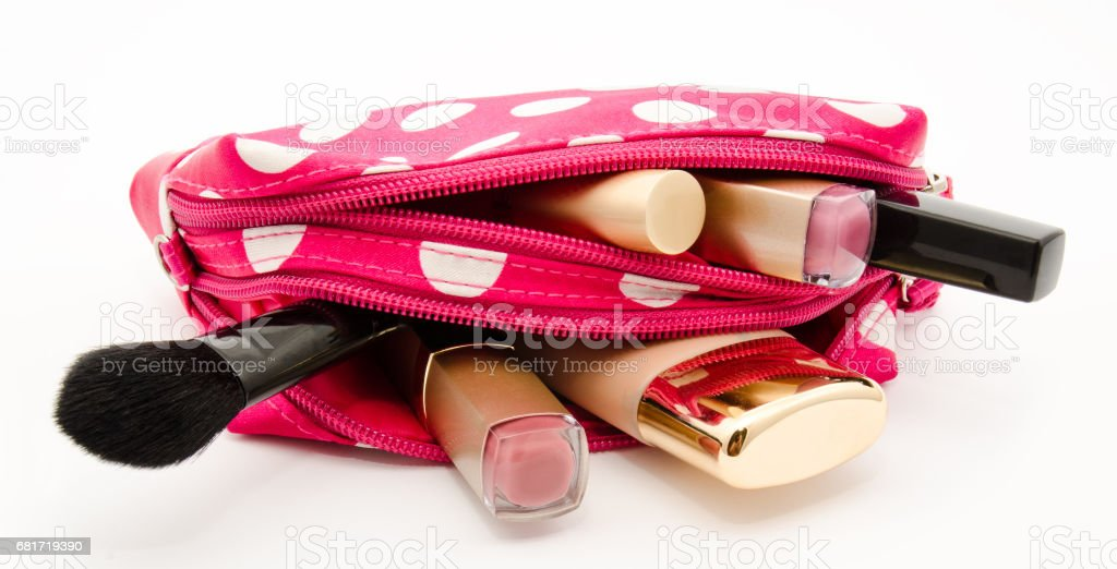 Pink make up bag with cosmetics isolated stock photo