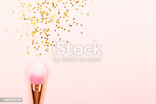 1040055260istockphoto Pink makeup brush and confetti 1085918764
