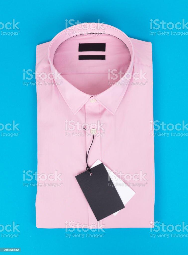 Pink man shirt on blue background zbiór zdjęć royalty-free