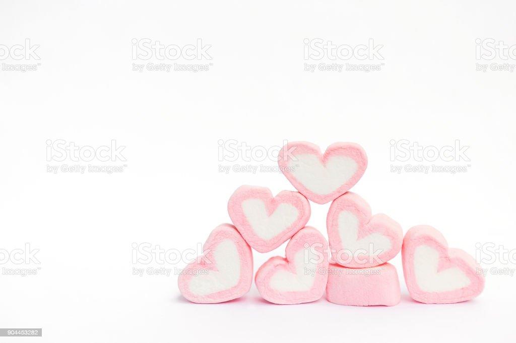 Pink marshmallow heart shape on white background stock photo