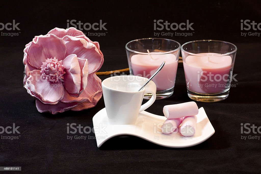 Pink marshmallow, rose and candles. stock photo