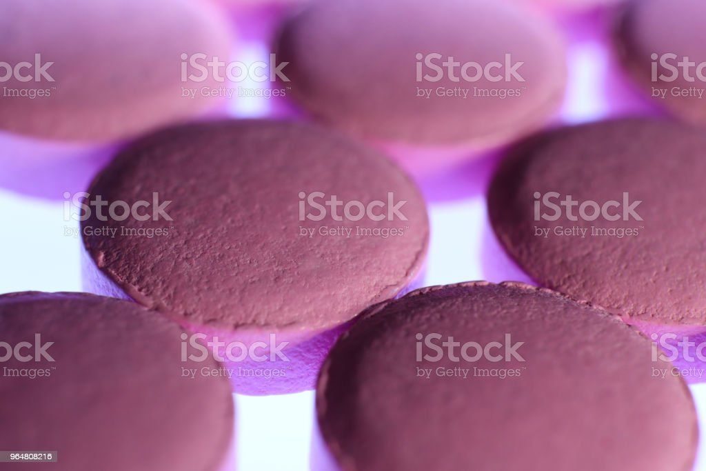 Pink Medicine Tablets. Pharmacy Pills Background. Macro Closeup. royalty-free stock photo