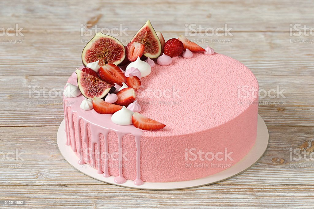 Pink mousse cake with mirror glaze and merinques stock photo