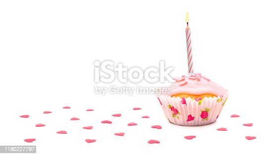 istock Pink muffin with hearts and birthday candle 1180227797