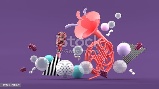 istock Pink musical instruments amid colorful balls on blue and purple background.-3d render. 1253073022