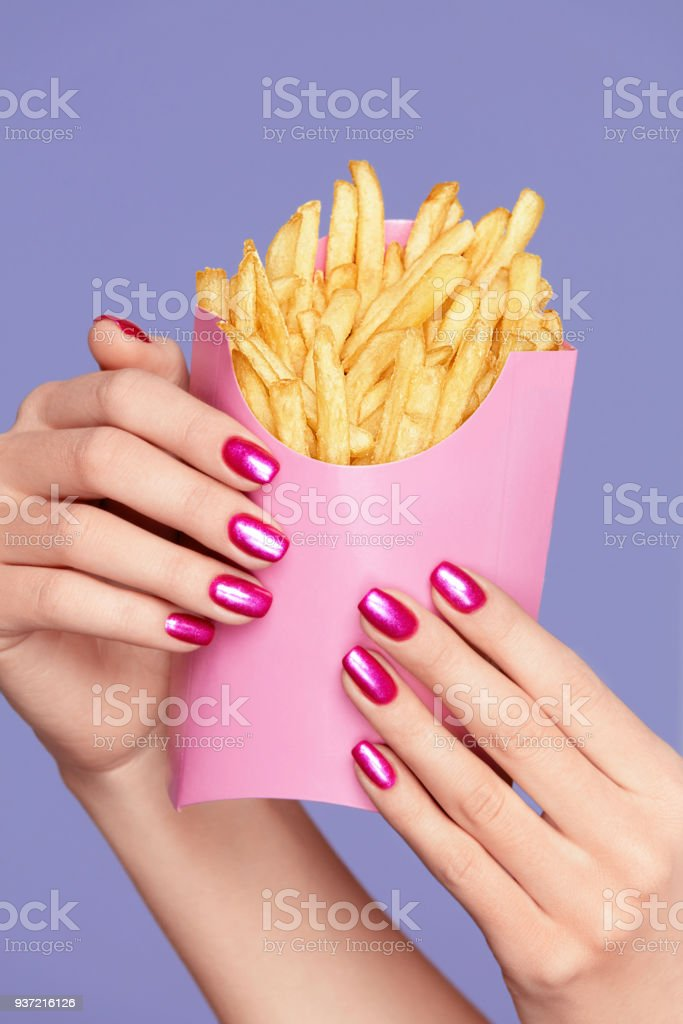 Pink Nails Female Hands And Fries Stock Photo & More Pictures of ...