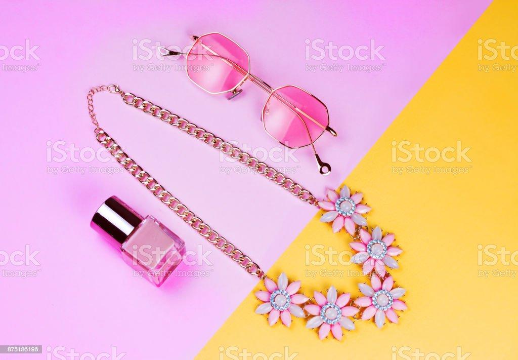 pink necklace, pink sunglasses and nail polish stock photo