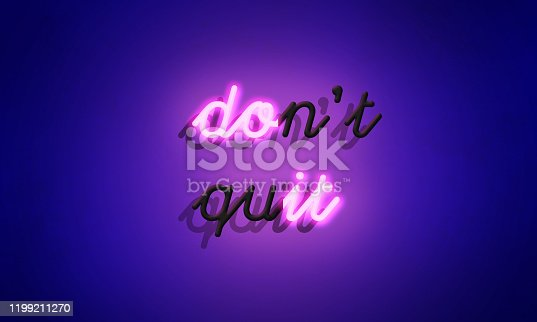 Pink Neon sign 'Don't quit' on blue wall background