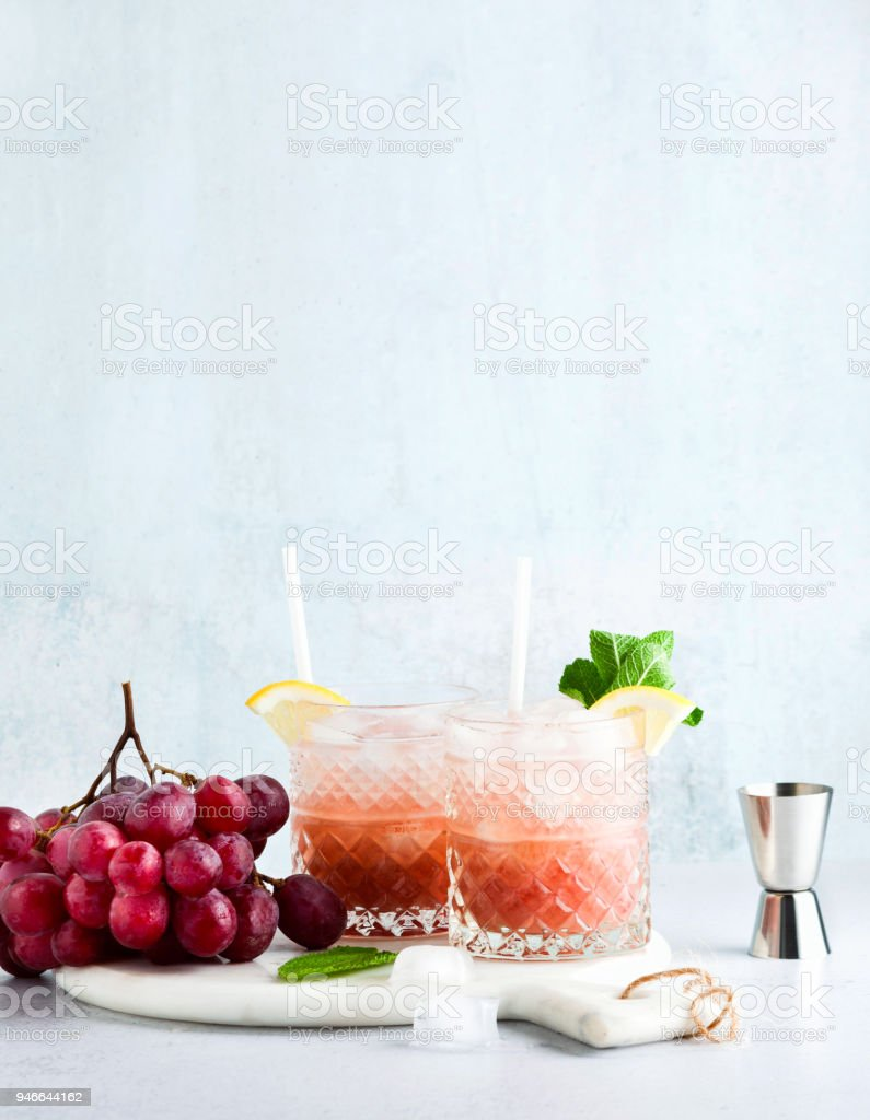 pink non-alcoholic  moсktail made from grapes with lemon and mint. summer refreshing drink stock photo
