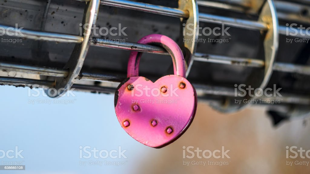 Pink Padlock in the shape of heart stock photo