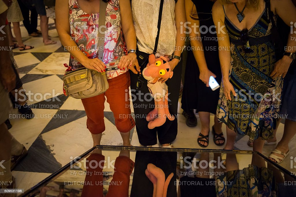 Pink Panther and tourists at Seville Cathedral, Spain stock photo