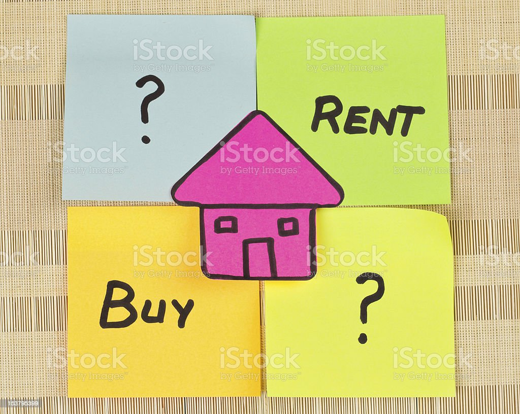 Pink paper house on sticky notes with either to rent or buy royalty-free stock photo