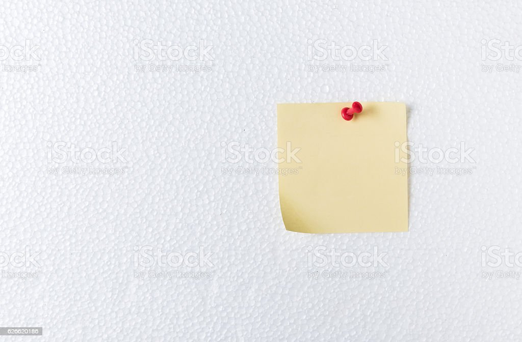 pink paper note with pin on foam sheet stock photo