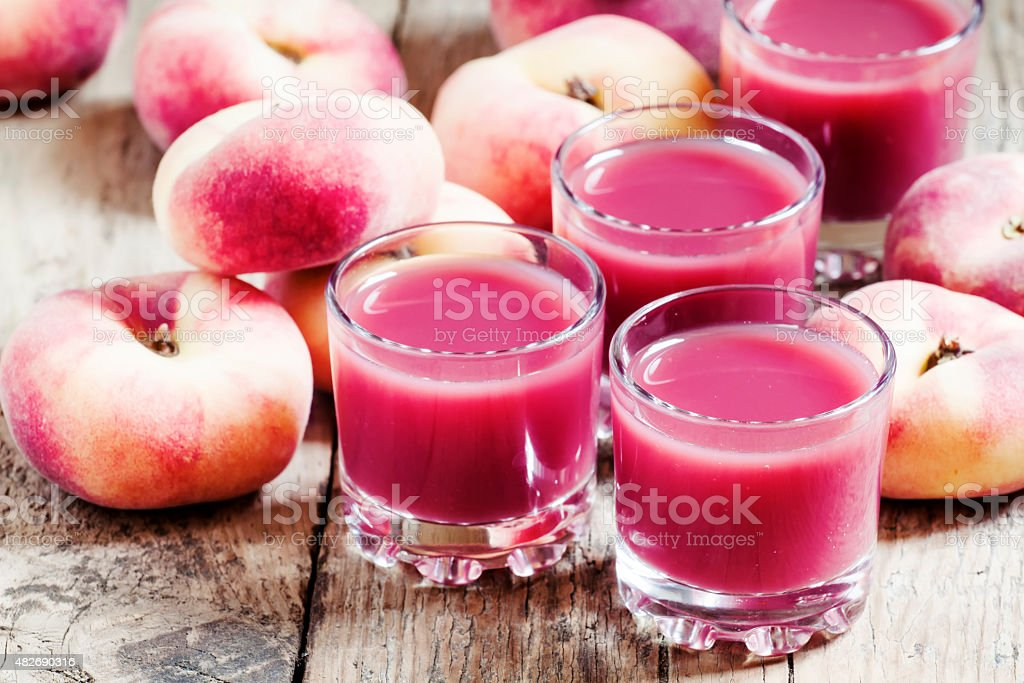 Pink peach juice with pulp stock photo