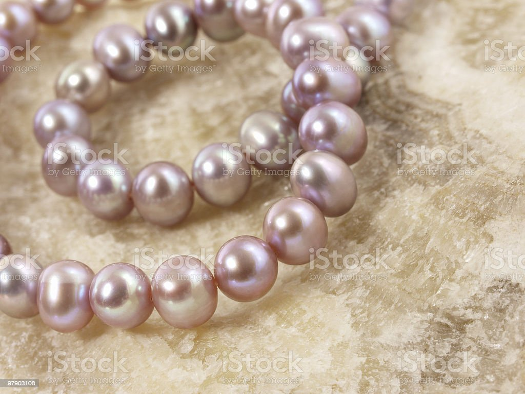 Pink pearls on a stone royalty-free stock photo