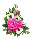 istock Pink peonies and anemone flowers in a corner floral arrangement 952720370