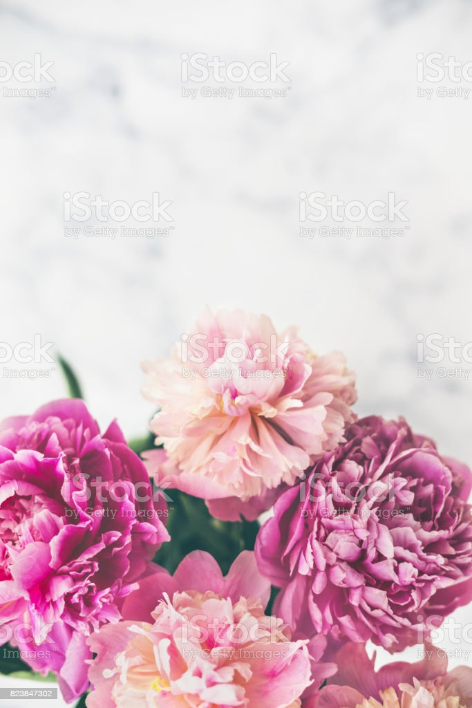 Pink Peonies Bouquet On Marble Background Stock Photo