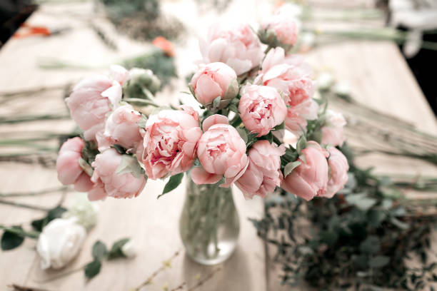 Pink peonies in vase on wooden floor and bokeh background retro picture id690326658?b=1&k=6&m=690326658&s=612x612&w=0&h=o2iowiiwoc vadk4ggv0aupmj59ohtellubafw4wqxw=