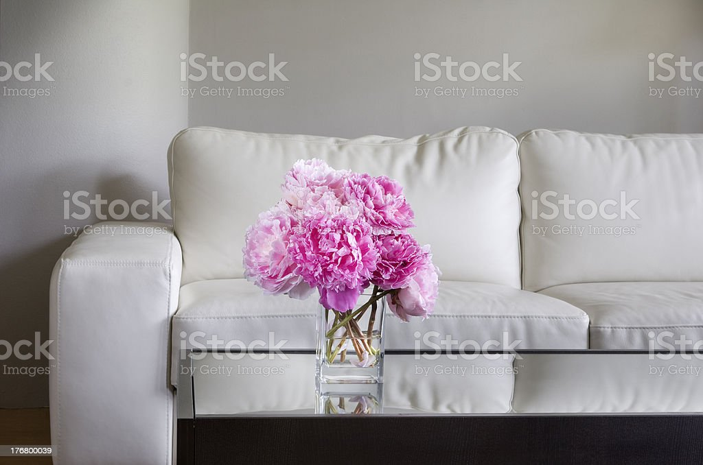 pink peonies in white living room royalty-free stock photo