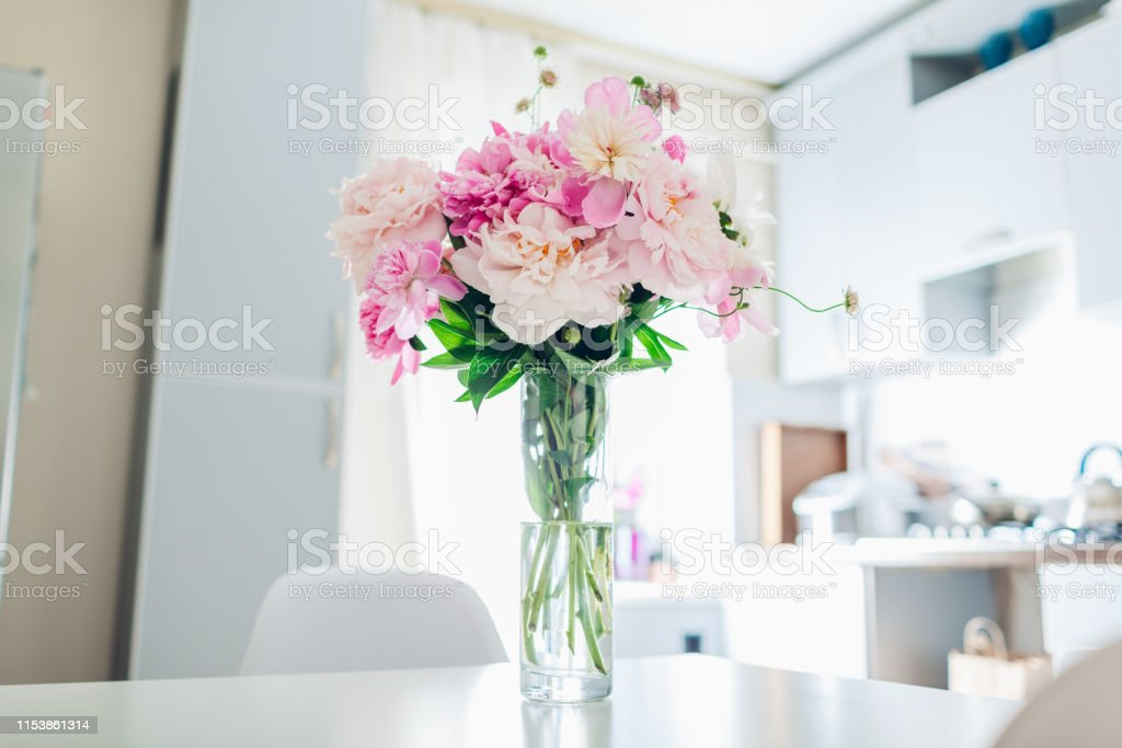 Pink Peonies Modern Kitchen Design Interior Of White And Silver Kitchen Decorated With Flowers Stock Photo Download Image Now Istock