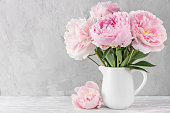 istock pink peony flowers bouquet on white background with copy space. still life. womens day or wedding concept 1199050098