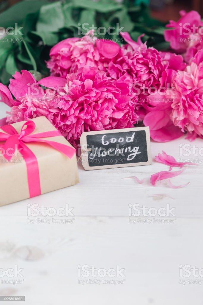 Pink peony flowersgift box and notes good morning on white rustic pink peony flowersgift box and notes good morning on white rustic table from above mightylinksfo