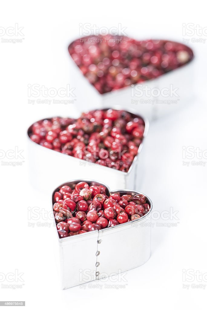 Pink Peppercorns Heart Shape (on white) stock photo