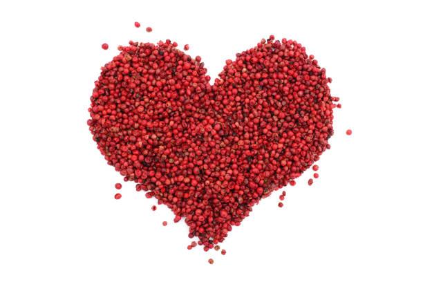 Grains de poivre roses en forme de coeur - Photo